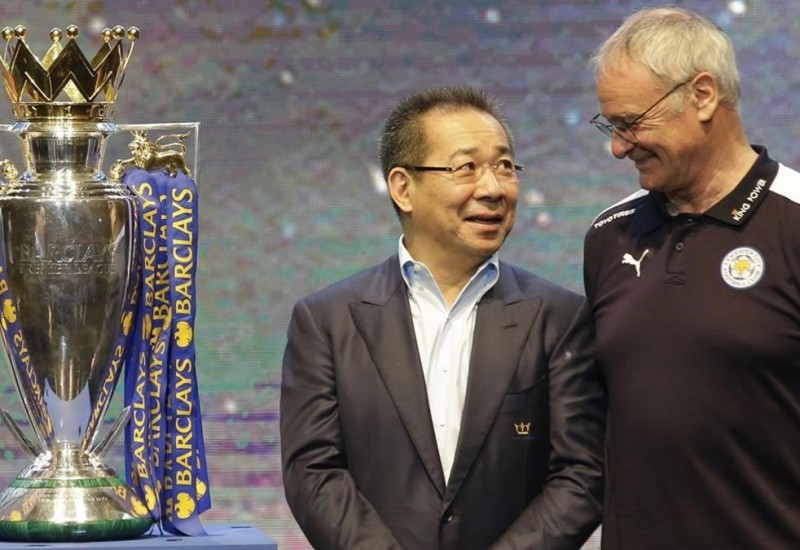 FILE - In this Wednesday  May 18  2016 file photoLeicester City s chairman Vichai Srivaddhanaprabha  left  talks to Leicester City s Manager Claudio Ranieri beside the English Premier League soccer champions trophy during a press conference in Bangkok  Thailand  Leicester City announced Thursday  Feb  23  2017 that they have sacked manager Claudio Ranieri less than a year after their incredible run to the Premier League title   AP Photo Sakchai Lalit  File